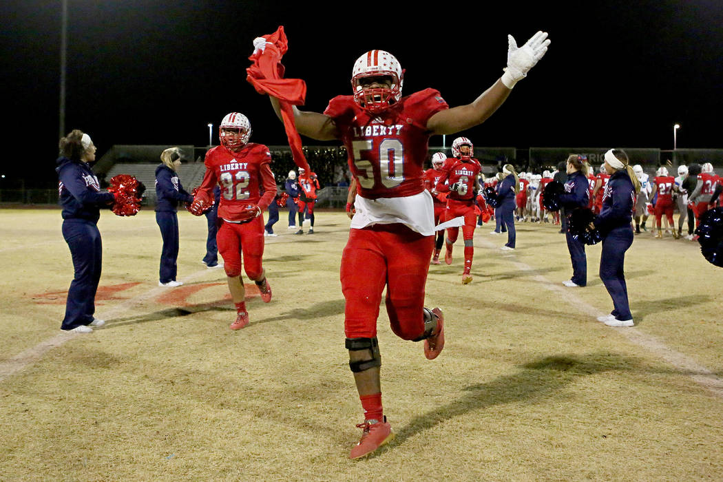 Liberty player Brandon Yates (50) celebrates after the class 4A Sunrise Region title game against Green Valley at Liberty High School Friday, Nov. 17, 2017, in Henderson. Liberty won 32-10. (Bridg ...