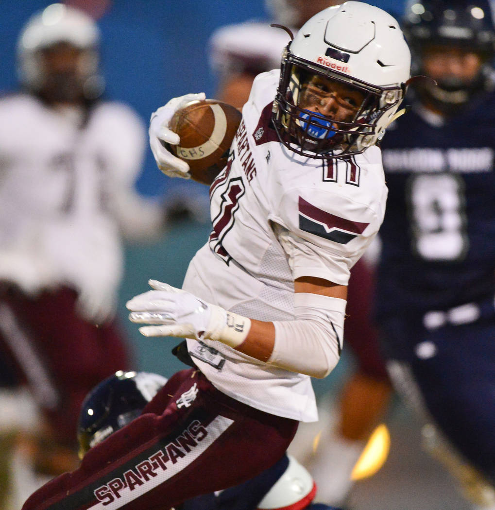 Cimarron Memorial's Jose Carrasco (11) spins away from a hit during a game against Shadow Ridge at Shadow Ridge High School in Las Vegas on Friday, Sept. 14, 2018. Brett Le Blanc/Las Vegas Review- ...