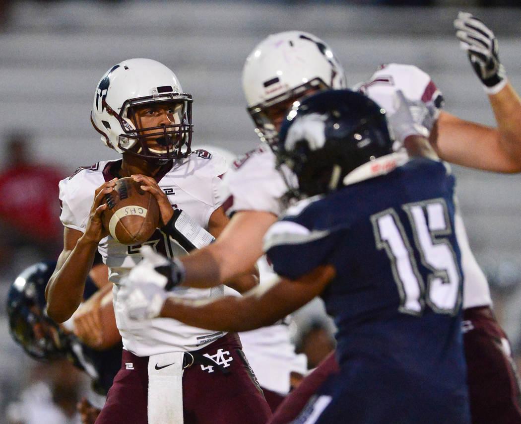 Cimarron-Memorial quarterback Branden Smith (3) looks for an open receiver during a game against Shadow Ridge at Shadow Ridge High School in Las Vegas on Friday, Sept. 14, 2018. Brett Le Blanc/Las ...