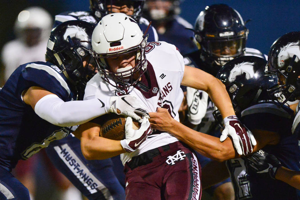 Cimarron-Memorial's Herbert Yannone (9) is tackled by a host of Shadow Ridge defenders during a game at Shadow Ridge High School in Las Vegas on Friday, Sept. 14, 2018. Brett Le Blanc/Las Vegas Re ...