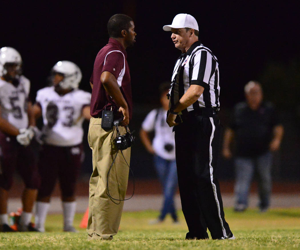 Cimarron-Memorial head coach Kory Walker talks to a referee during a game against Shadow Ridge at Shadow Ridge High School in Las Vegas on Friday, Sept. 14, 2018. Brett Le Blanc/Las Vegas Review-J ...