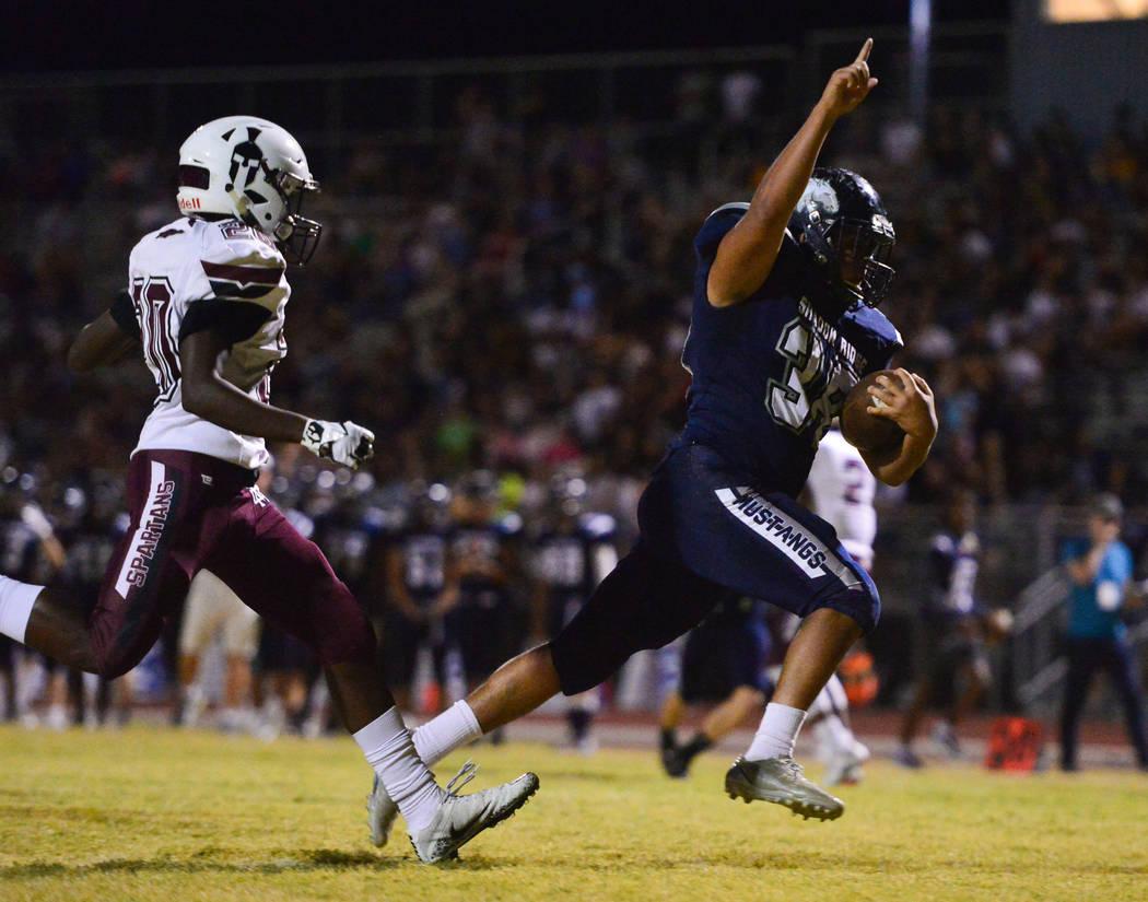 Shadow Ridge running back Xavier Gomez (38) scores a touchdown against Cimarron-Memorial during a game at Shadow Ridge High School in Las Vegas on Friday, Sept. 14, 2018.Brett Le Blanc/Las V ...