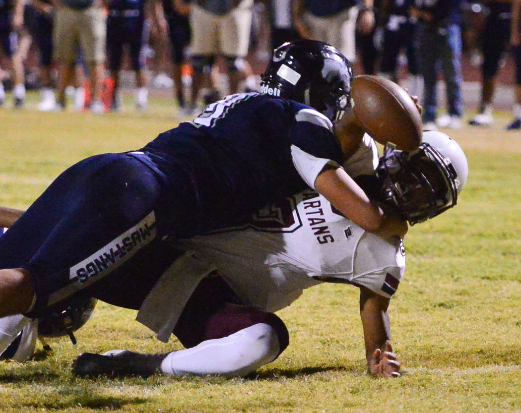 Cimarron-Memorial quarterback Branden Smith (3) reaches out to complete a two-point conversion against Shadow Ridge at Shadow Ridge High School in Las Vegas on Friday, Sept. 14, 2018.Brett L ...