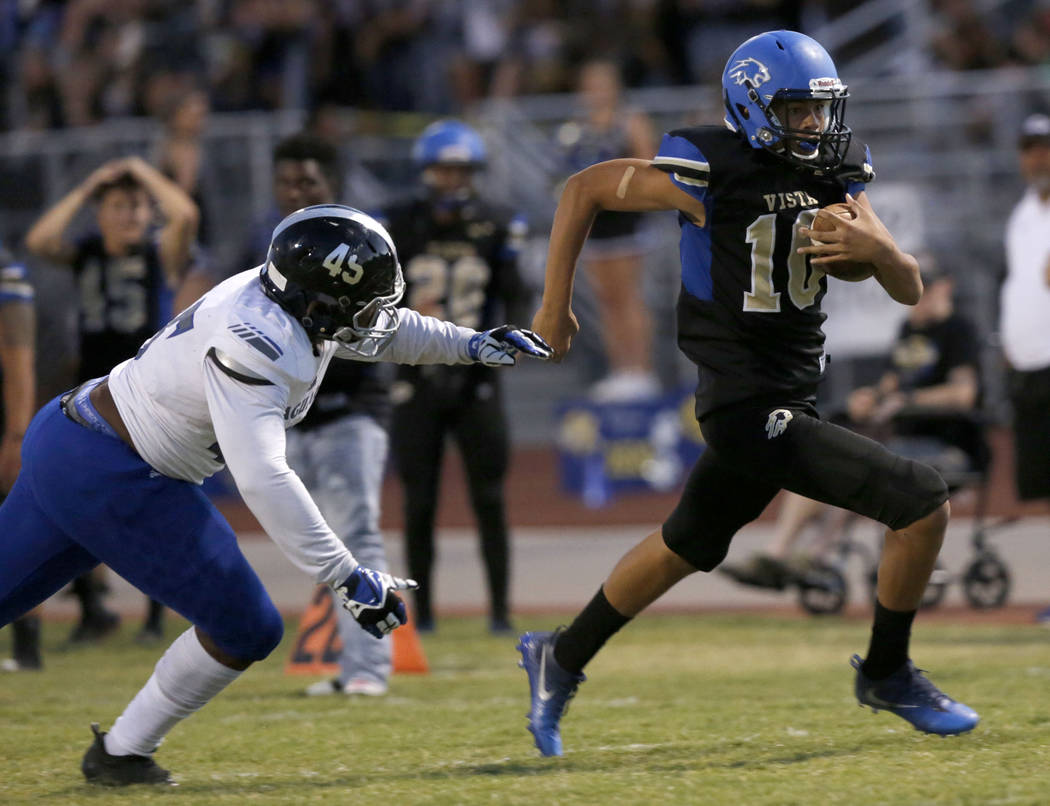Sierra Vista's quarterback Jayden Maiava (10) scores a touchdown over Desert Pines' Braezhon Ross (45) during the first half of a football game at Sierra Vista High School in Las Vegas, Friday, S ...