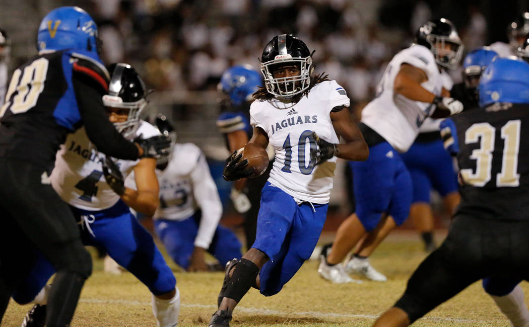 Desert Pines' Devin Megee (10) carries a ball during the first half of a football game at Sierra Vista High School in Las Vegas, Friday, Sept. 14, 2018. Chitose Suzuki Las Vegas Review-Journal @ch ...