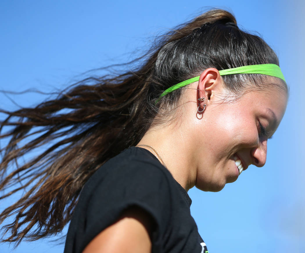 Green Valley's Taylor O'Neill, 17, smiles as she looks down to grab a ball during a team practice at Green Valley High School in Henderson, Tuesday, Sept. 18, 2018. Caroline Brehman/Las Vegas Revi ...