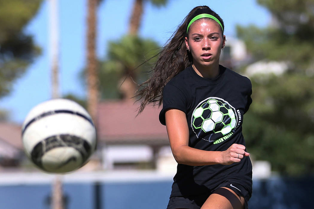 Green Valley's Taylor O'Neill, 17, passes to a teammate during team practice at Green Valley High School in Henderson, Tuesday, Sept. 18, 2018. Caroline Brehman/Las Vegas Review-Journal