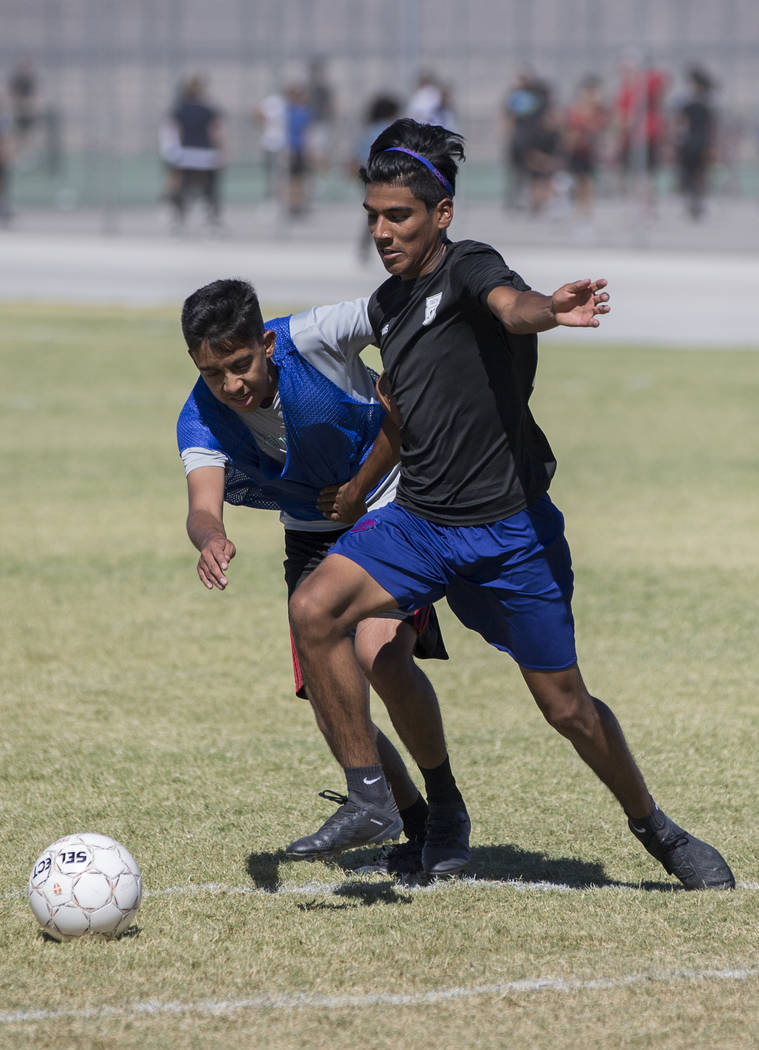 Senior defender Allan Garcia, right, fights for possession during practice at Southeast Career Technical Academy on Tuesday, Sept. 18, 2018, in Las Vegas. Benjamin Hager Las Vegas Review-Journal @ ...