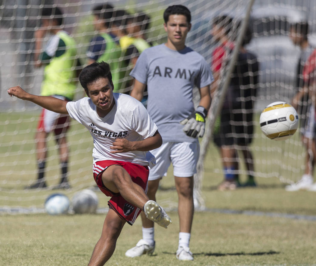 Senior forward Eduardo Gomez, left, passes the ball up field during practice at Southeast Career Technical Academy on Tuesday, Sept. 18, 2018, in Las Vegas. Benjamin Hager Las Vegas Review-Journal ...