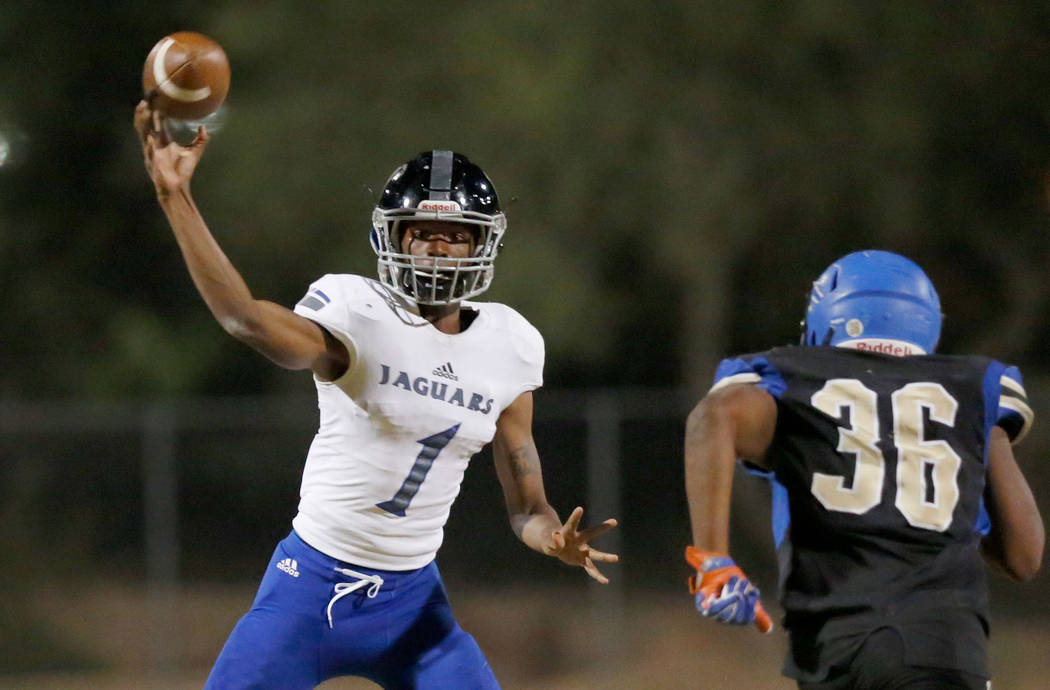 Desert Pines' quarterback Tyler Williamson (1) throws against Sierra Vista's Javaris Andrews (36) during the first half of a football game at Sierra Vista High School in Las Vegas, Friday, Sept. 1 ...
