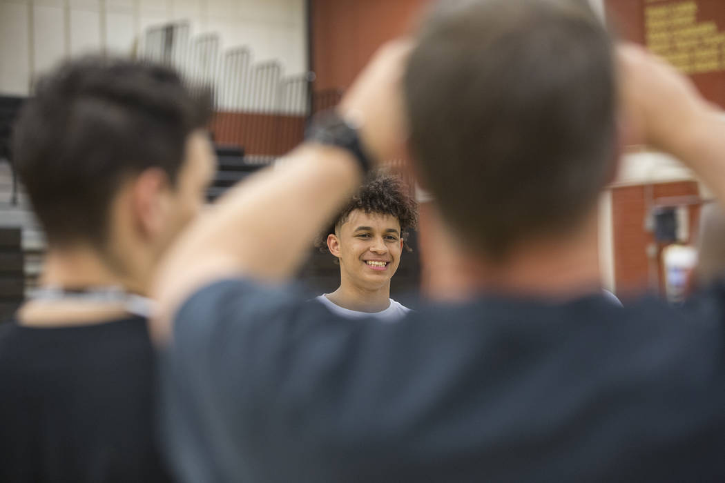 Clark senior Jalen Hill takes photos during an event to announce his commitment to play basketball at the University of Oklahoma on Thursday, Sept. 20, 2018, at Clark High School, in Las Vegas. Be ...