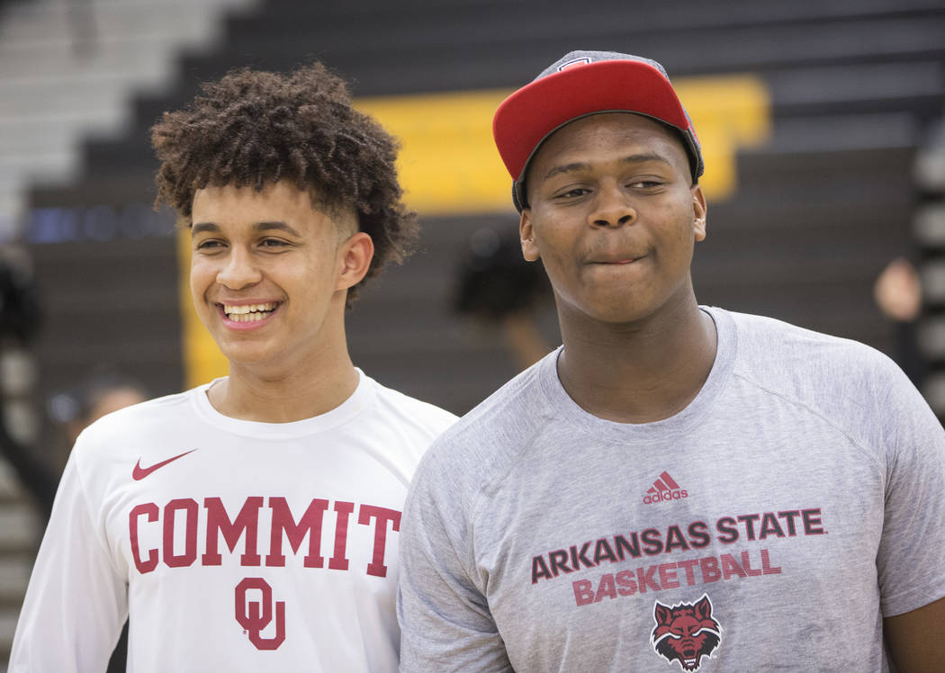 Clark seniors Jalen Hill, left, and Antwon Jackson take photos during an event to announce Hill's commitment to play basketball at the University of Oklahoma, while Jackson will attend Arkansas St ...