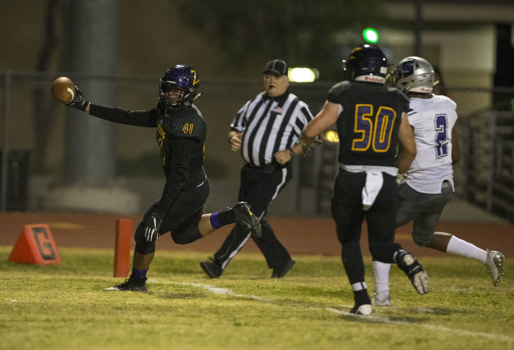Durango's Frankie Pelton (41), left, scores a touchdown against Silverado during the first half of a varsity football game at Durango High School in Las Vegas on Friday, Sept. 21, 2018. Richard Br ...