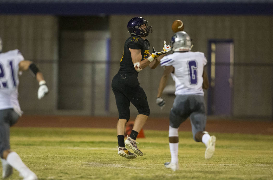 Durango's Jayden Nersinger (33), center, makes a catch for a touchdown against Silverado during the first half of a varsity football game at Durango High School in Las Vegas on Friday, Sept. 21, 2 ...