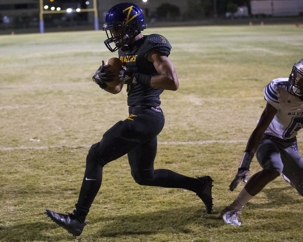 Durango's Michael Jackson (3), left, scores a touchdown against Silverado during the second half of a varsity football game at Durango High School in Las Vegas on Friday, Sept. 21, 2018. Richard B ...