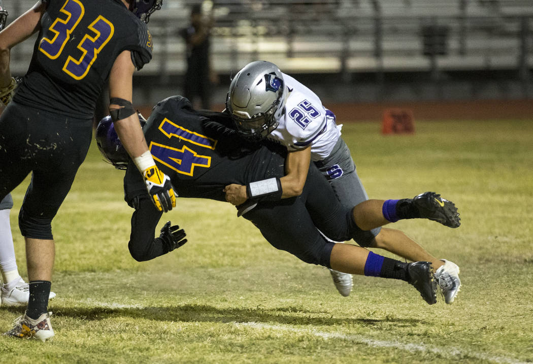 Durango's Frankie Pelton (41) crosses into the end zone for a touchdown as he is tackled by Silverado's Jeremy Alipio (25) during the second half of a varsity football game at Durango High School ...