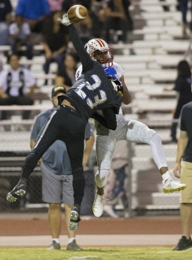 Desert Pines junior cornerback Andrew Williams (23) knocks the ball away from Liberty junior wide receiver Maurice Hampton (16) in the first quarter during the Jaguars home game with the Patriots ...
