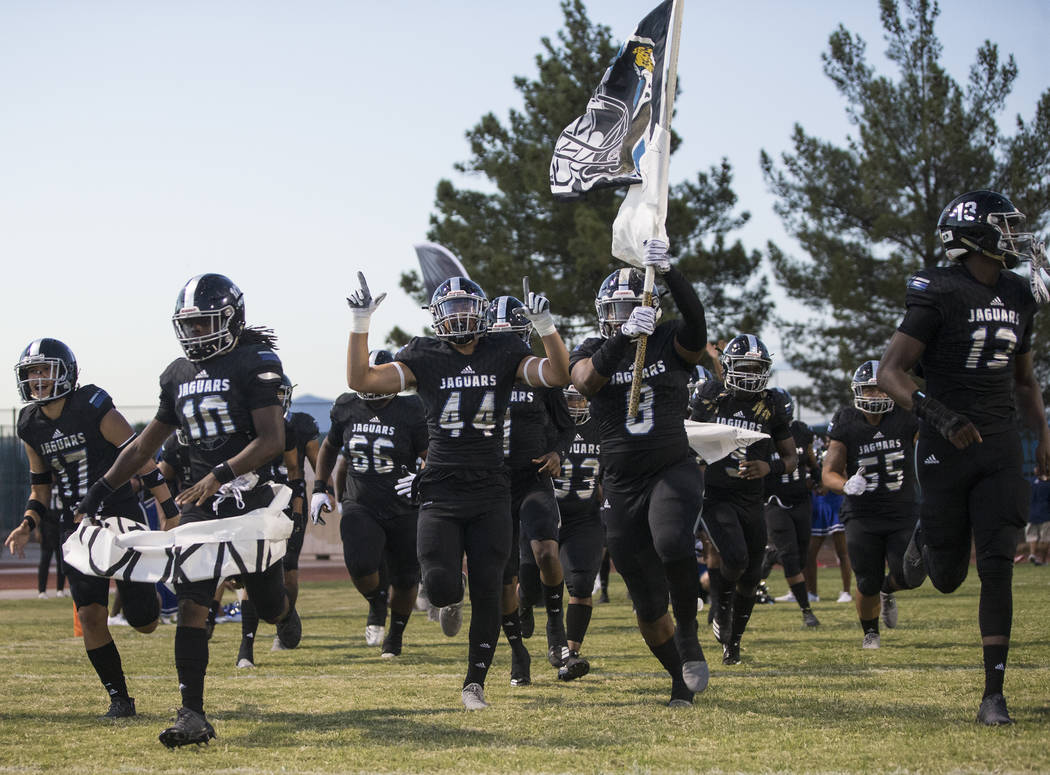 Desert Pines takes the field before the start of the Jaguars home game with the Liberty Patriots on Friday, Sept. 21, 2018, at Desert Pines High School, in Las Vegas. Benjamin Hager Las Vegas Revi ...