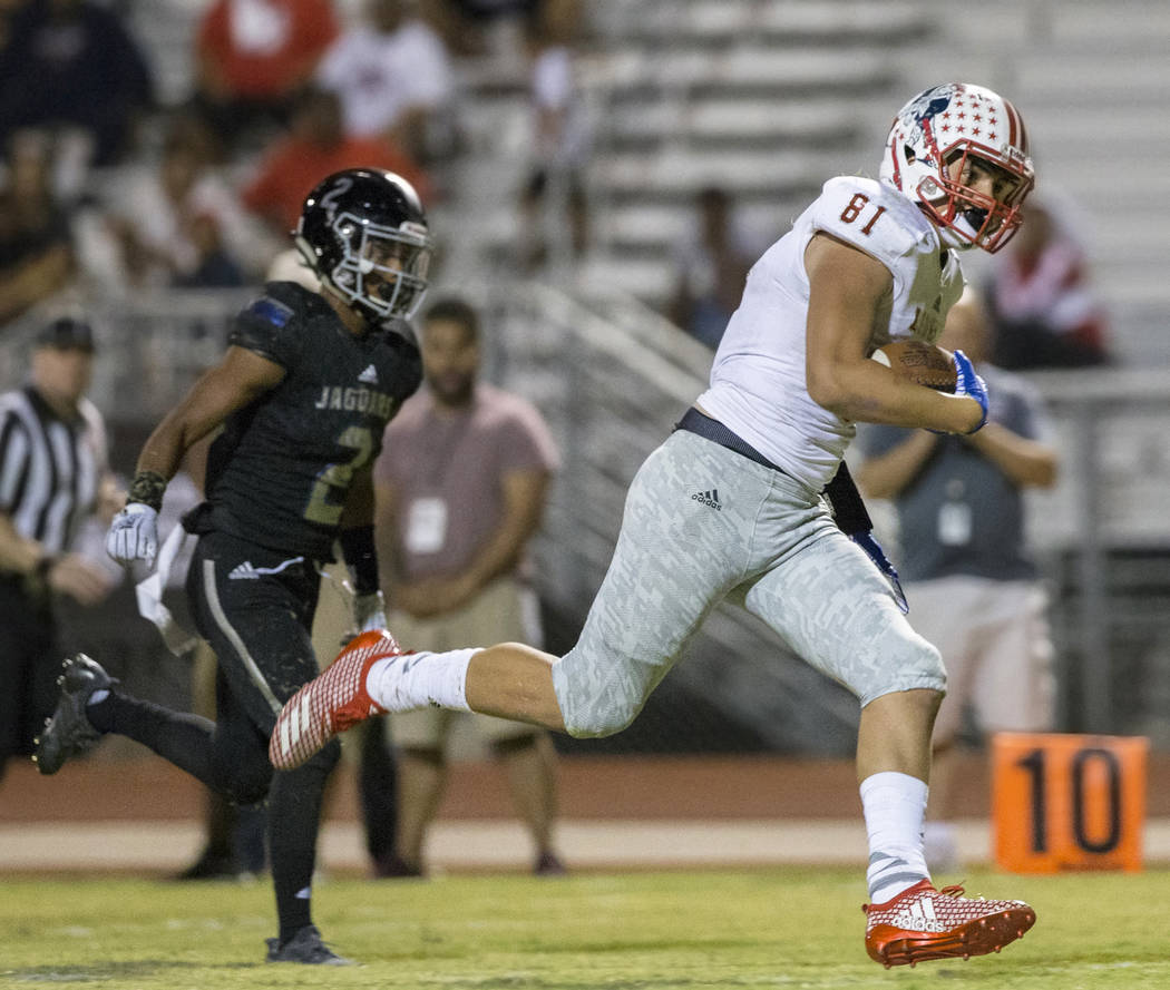 Liberty sophomore tight end Moliki Matavao (81) sprints up field for a fourth quarter touchdown catch past Desert Pines cornerback receiver Tye Moore (2) during the Patriots road game with the Jag ...