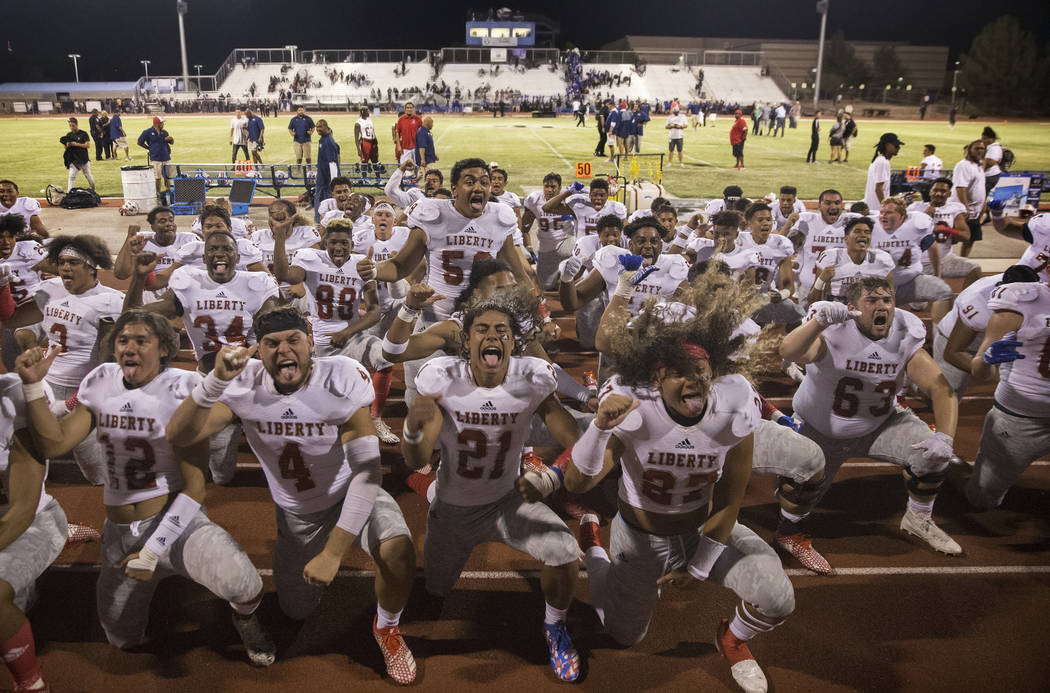 Liberty celebrates their road victory over the Desert Pines Jaguars on Friday, Sept. 21, 2018, at Desert Pines High School, in Las Vegas. Benjamin Hager Las Vegas Review-Journal @benjaminhphoto