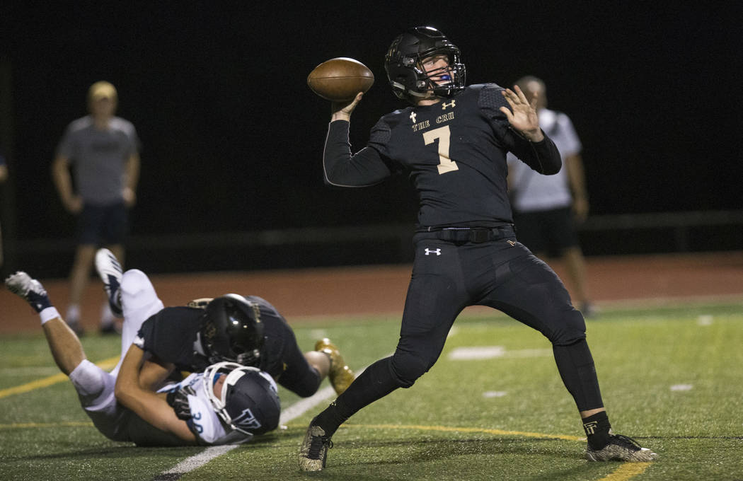 Faith Lutheran quarterback Sagan Gronauer (7) throws a pass against Valor Christian (Colorado) during the second half of varsity football game at Faith Lutheran High School in Las Vegas on Friday, ...