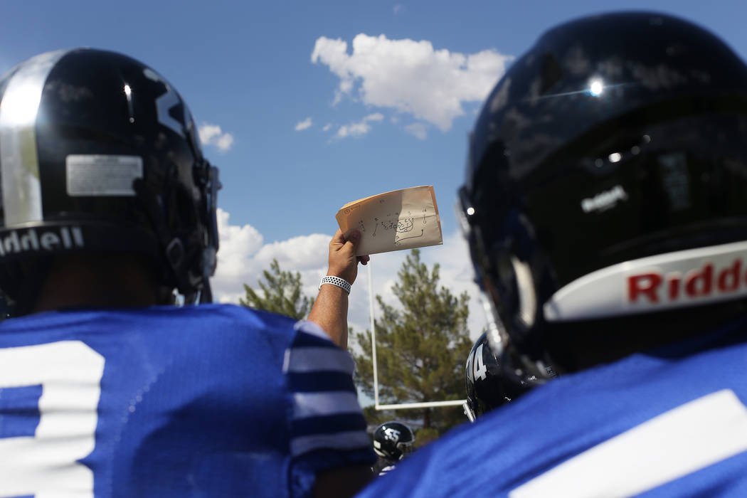 Desert Pines High School Coach Tico Rodriguez holds a play for the team practice at Desert Pines High School in Las Vegas, Wednesday, Sept. 5, 2018. Rachel Aston Las Vegas Review-Journal @rookie__rae