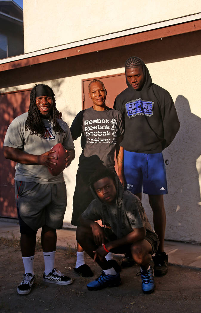 Desert Pines High School Assistant Coach David Hill, from left, Katrina Graves, and her sons Ezekiel Washington and Darnell Washington in Las Vegas, Wednesday, Sept. 5, 2018. Rachel Aston Las Vega ...