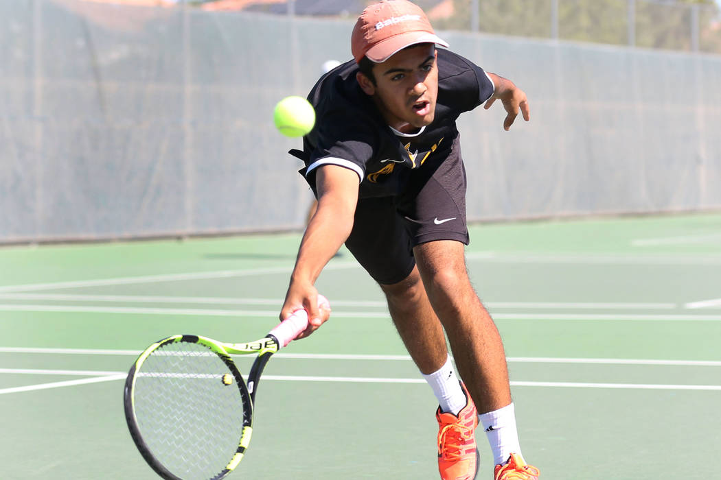Clark High singles player Rahul Gupte returns the ball against Coronado High's Ethan Quandt during Desert Region boys tennis championship match at Liberty High School on Friday, Oct. 5, 2018, in H ...