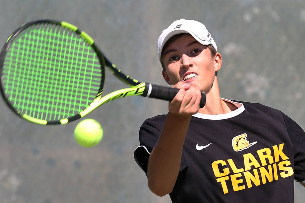 Clark High single player Max Foels returns the ball against Coronado High's Sebastian Frace during Desert Region boys tennis championship match at Liberty High School on Friday, Oct. 5, 2018, in H ...