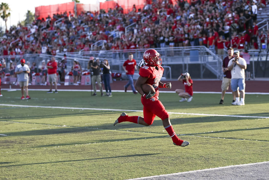 Arbor View Aggies running back Kyle Graham (25) runs the ball for a touchdown against the Valley View Eagles during the first half of a varsity football game at Arbor View High School in Las Vegas ...