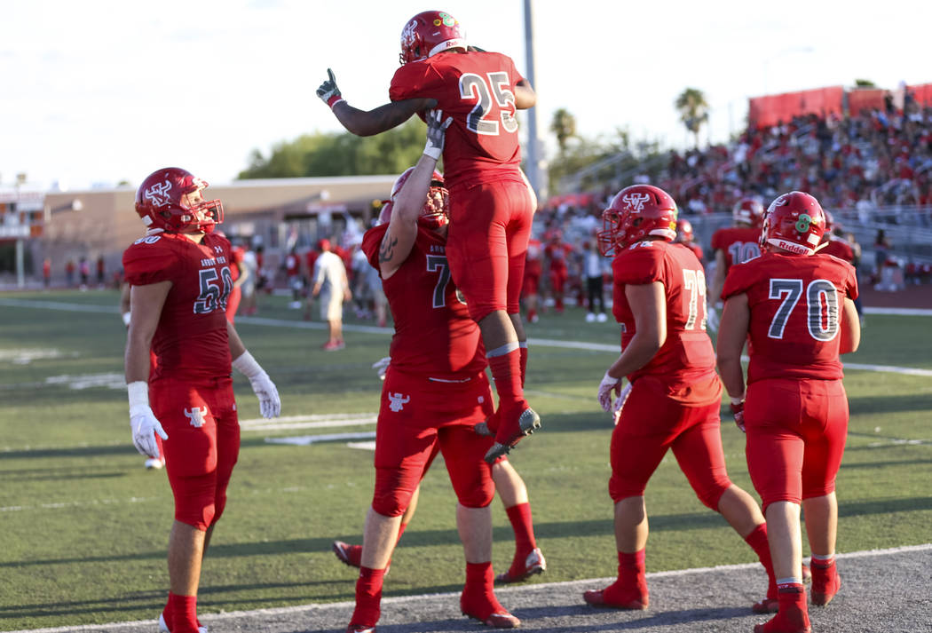 Arbor View Aggies running back Kyle Graham (25) celebrates with teammates after scoring a touchdown against the Valley View Eagles during the first half of a varsity football game at Arbor View Hi ...
