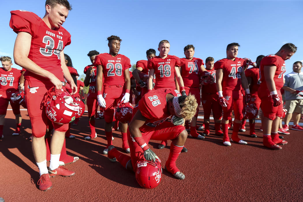 Arbor View Aggies running back Kyle Graham (25) kneels in prayer before playing the Valley View Eagles of California in a varsity football game at Arbor View High School in Las Vegas on Friday, Au ...