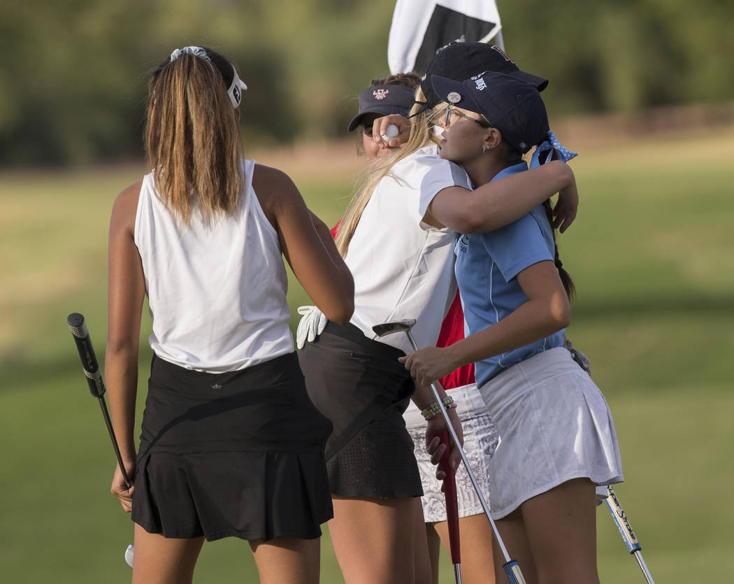 Centennial sophomore McKenzi Hall gets a hug from Faith Lutheran sophomore Gracie Olkowski after winning the region golf tournament at Stallion Mountain Golf Club on Wednesday, Oct. 10, 2018, in L ...