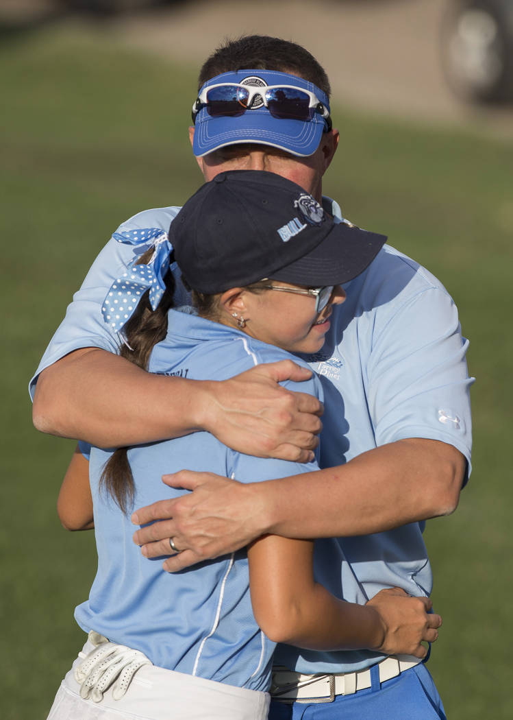 Centennial sophomore McKenzi Hall gets a hug from her dad Ken Hall after winning the region golf tournament at Stallion Mountain Golf Club on Wednesday, Oct. 10, 2018, in Las Vegas. Benjamin Hager ...