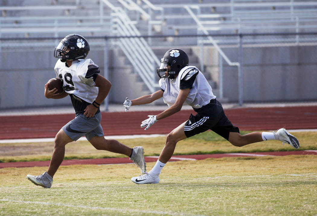 Palo Verde High School player Michael Torres (49) runs the ball during practice at Palo Verde High School in Las Vegas, Thursday, Oct. 11, 2018. Rachel Aston Las Vegas Review-Journal @rookie__rae