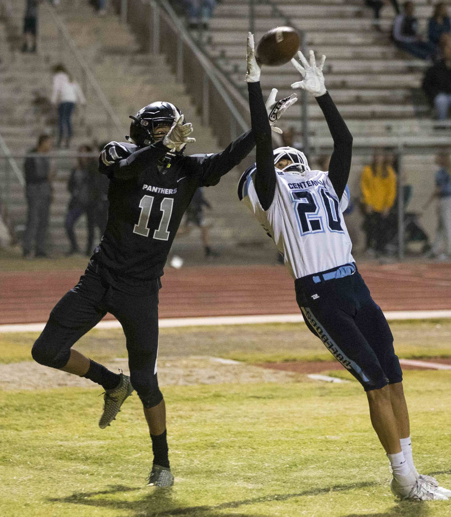 Centennial's Davone Walden Jr. (20) intercepts a pass in the end zone intended for Palo Verde's Karsonne Winters (11) during the second half of a varsity football game at Palo Verde High School in ...
