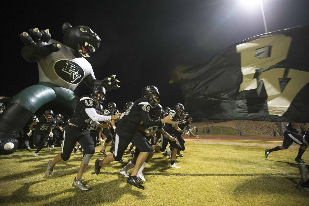 Palo Verde players hit the field before playing Centennial in a varsity football game at Palo Verde High School in Las Vegas on Friday, Oct. 12, 2018. Richard Brian Las Vegas Review-Journal @vega ...