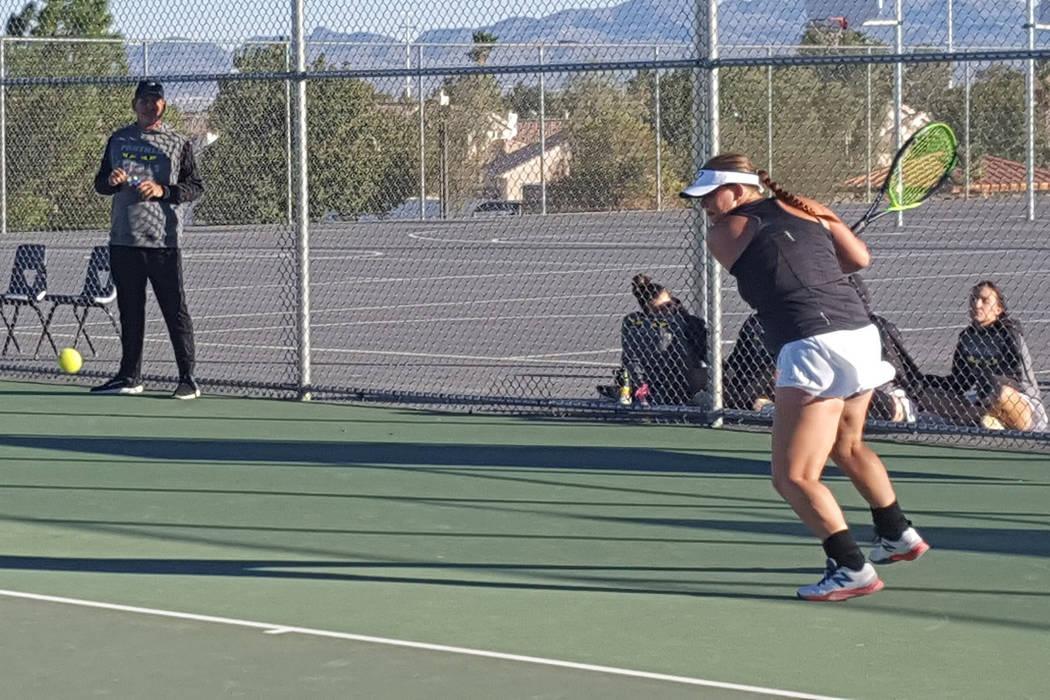 Palo Verde senior Shelby Graber prepares to return a shot in her singles match against Bishop Gorman senior Angelique Friedrich during the teams' state quarterfinal match Monday at Spring Valley. ...