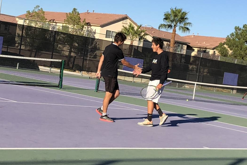 Clark's Artem Iermolov and Mathew Spagnolo celebrate a point during a doubles match against Bonanza on Monday, Oct. 15, at Durango High School. Sam Gordon/Las Vegas Review-Journal