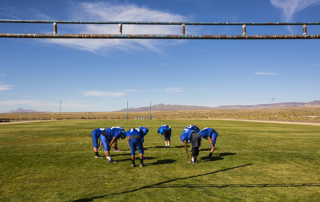 Football players stretch during practice at McDermitt High School in McDermitt on Tuesday, Sept. 25, 2018. Chase Stevens Las Vegas Review-Journal @csstevensphoto