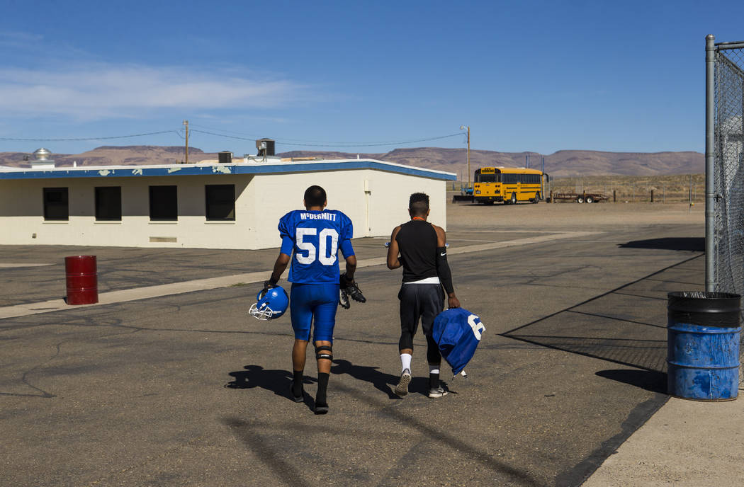 Football players Jagger Hinkey, left, and Ashton Alexander head to the field for football practice at McDermitt High School in McDermitt on Tuesday, Sept. 25, 2018. Chase Stevens Las Vegas Review- ...