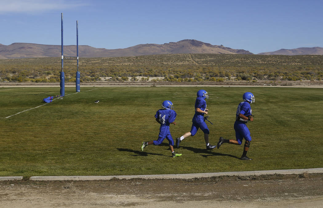 Football players run laps during practice at McDermitt High School in McDermitt on Tuesday, Sept. 25, 2018. Chase Stevens Las Vegas Review-Journal @csstevensphoto