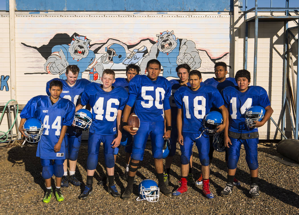 Members of the McDermitt High School football team pose for a photo in McDermitt on Tuesday, Sept. 25, 2018. Chase Stevens Las Vegas Review-Journal @csstevensphoto