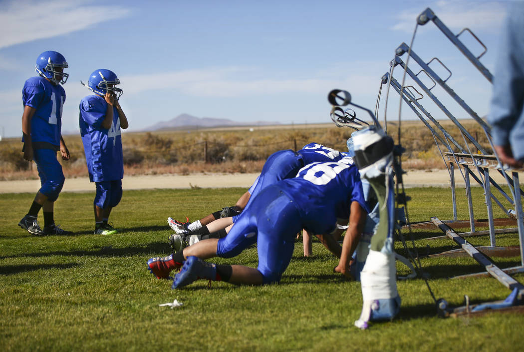 Football players run through drills during practice at McDermitt High School in McDermitt on Tuesday, Sept. 25, 2018. Chase Stevens Las Vegas Review-Journal @csstevensphoto
