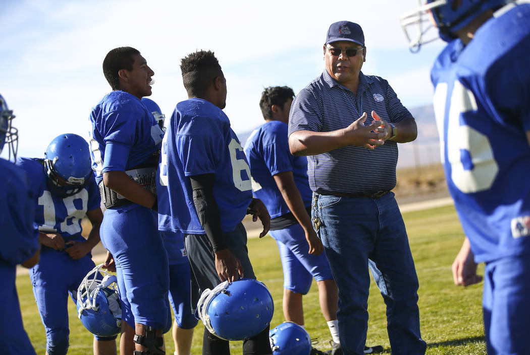 Football coach Richard Egan, right, leads practice at McDermitt High School in McDermitt on Tuesday, Sept. 25, 2018. Chase Stevens Las Vegas Review-Journal @csstevensphoto