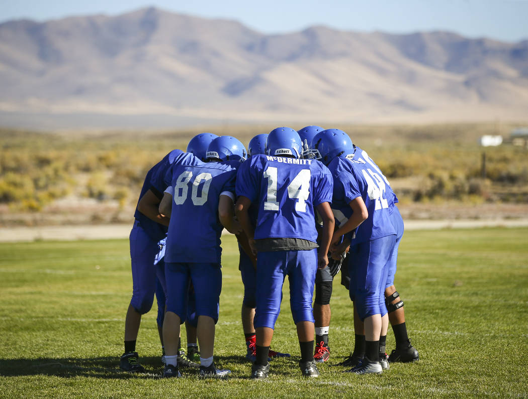 Football players huddle during practice at McDermitt High School in McDermitt on Tuesday, Sept. 25, 2018. Chase Stevens Las Vegas Review-Journal @csstevensphoto