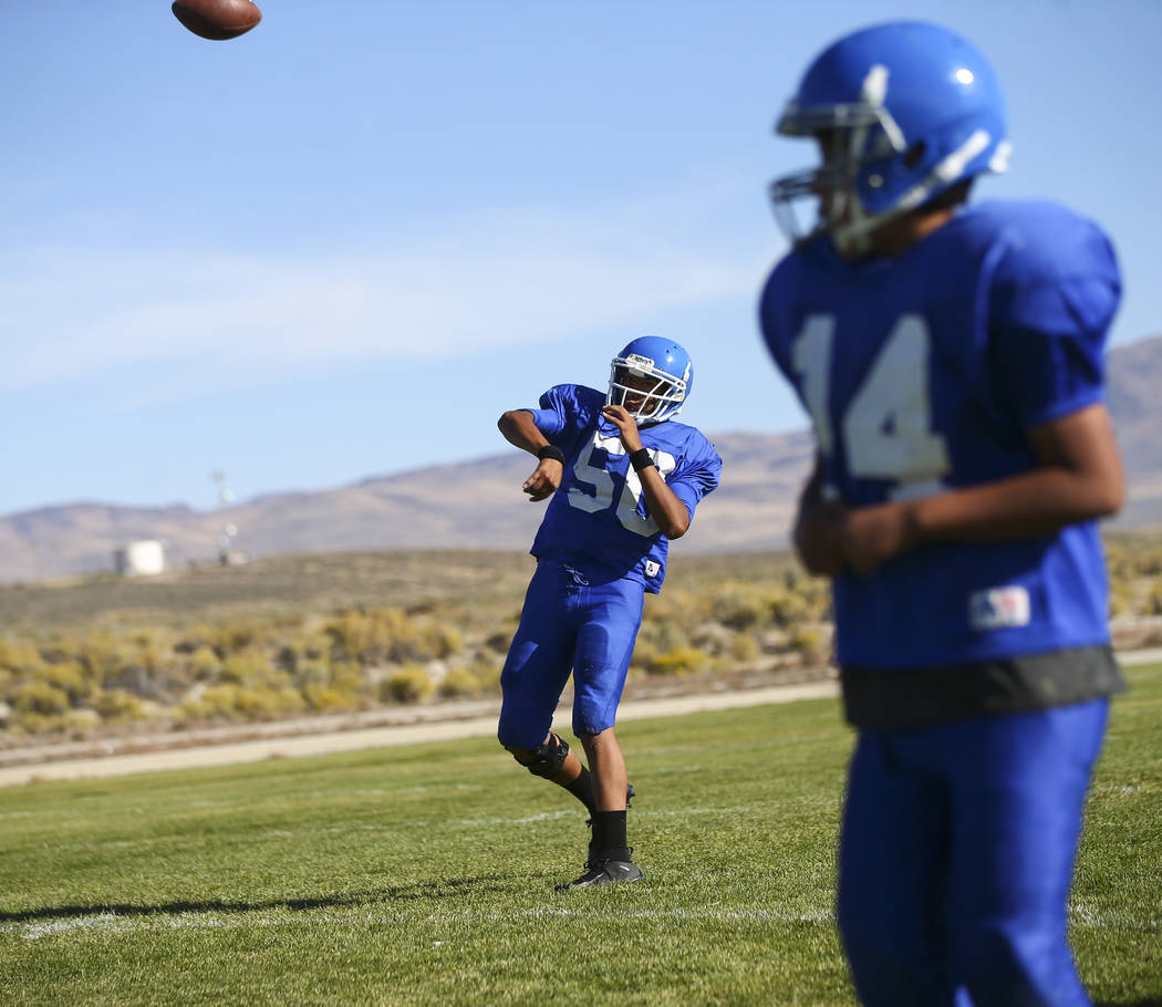 Quarterback Jagger Hinkey throws a pass during practice at McDermitt High School in McDermitt on Tuesday, Sept. 25, 2018. Chase Stevens Las Vegas Review-Journal @csstevensphoto