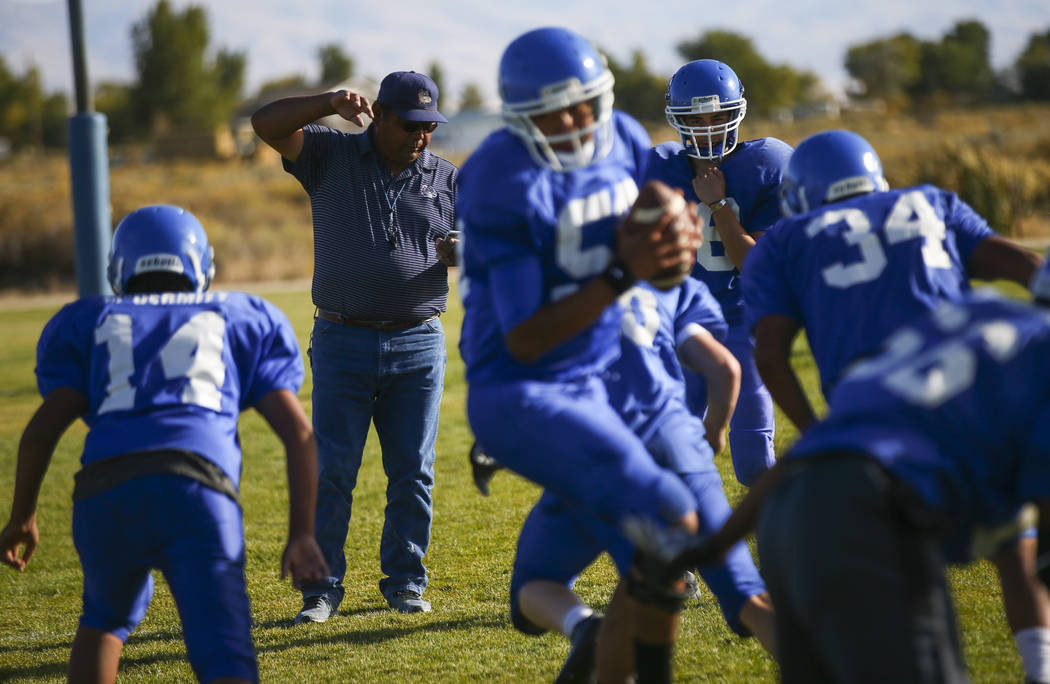 Football coach Richard Egan, center left, leads practice at McDermitt High School in McDermitt on Tuesday, Sept. 25, 2018. Chase Stevens Las Vegas Review-Journal @csstevensphoto