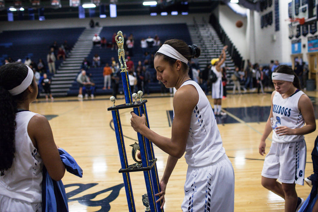 Centennial's Jade Thomas (5) holds the championship trophy after defeating Etiwanda 59-39 in the Las Vegas Holiday Classic basketball tournament at Centennial High School in Las Vegas, Friday, Dec ...