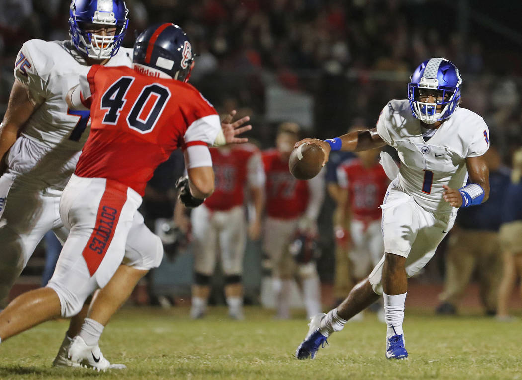 Bishop Gorman's Micah Bowens (1) scrambles away from Centennial's Derek Jodarski (40) during a game at Centennial High School in Peoria, Ariz. on Aug. 31, 2018. Patrick Breen The Arizona Republic